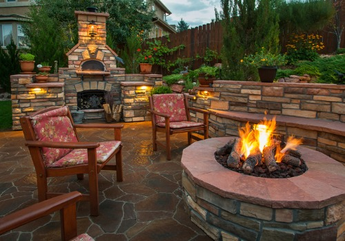 A backyard patio with Fire Pits in Peoria IL