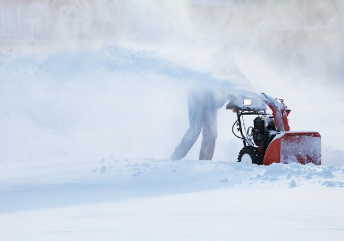 Professional using a heavy duty snow blower during Snow Removal in Bartonville IL