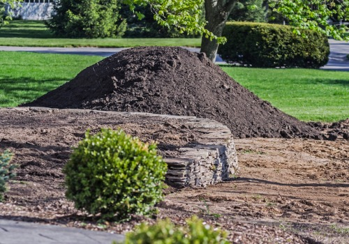 A Mound of dirt in a front yard, as part of Landscape Products in Peoria IL