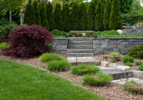 A garden in a back yard with Retaining Walls in Peoria IL