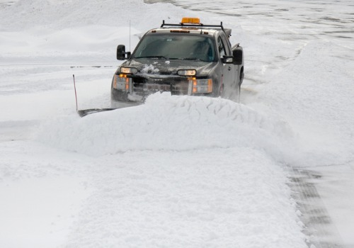 A truck plowing snow, as a part of Commercial Snow Removal in Companies Bartonville IL