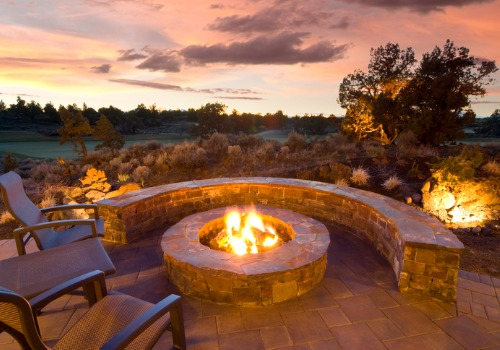 Outdoor furniture and a brick wall around Fire Pits in Peoria IL